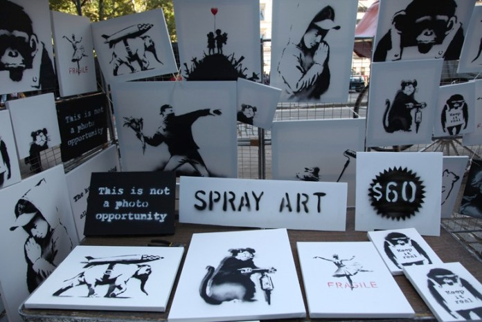 Banksy: Better Out Than In – In Central Park selling canvases