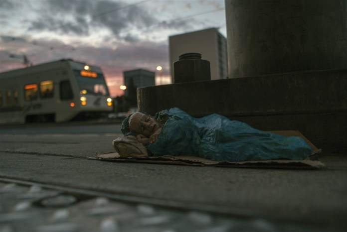 American dream. San Jose, EEUU. Cement Eclipses -By Isaac Cordal 2013 in 1