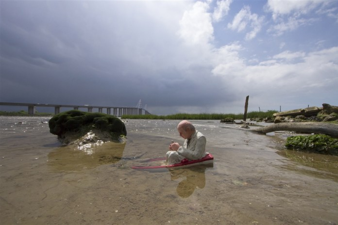 Slowly sinking. St Nazaire, France. Cement Eclipses -By Isaac Cordal 2013 in 17