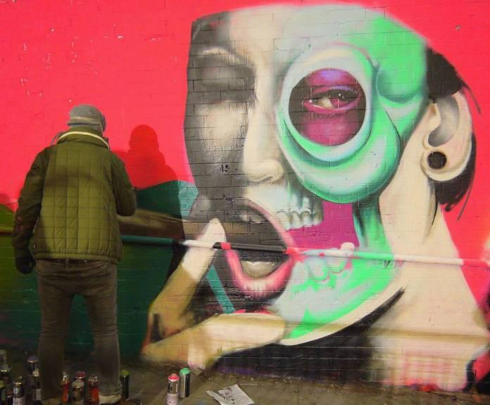 Graffiti of woman smoking a cigar, by CBLOXX