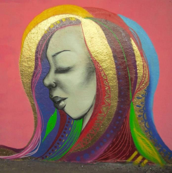 Street artist Miss Hazard adds her addition to Leake Street Tunnel