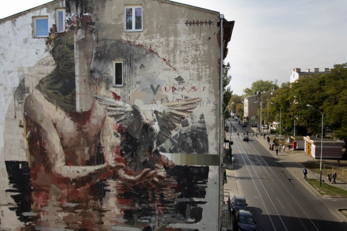 Mural by Borondo in Lodz, Poland 1