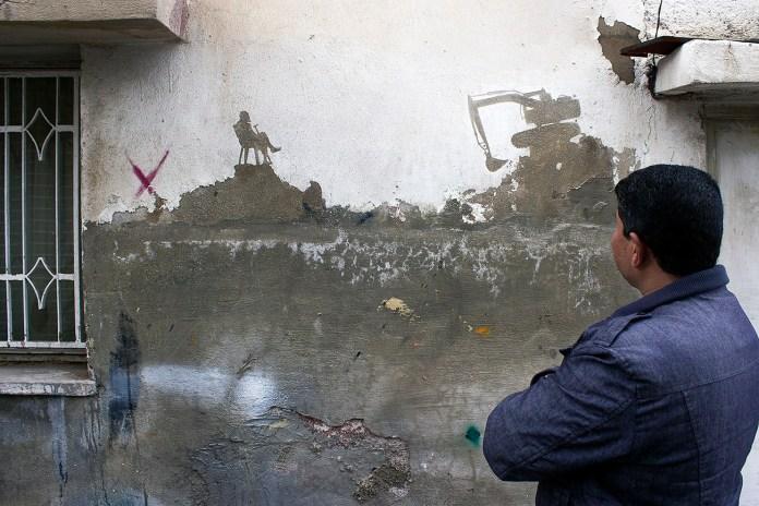 Street Art by Pejac in Al-Hussein, a Palestinian refugee camp in Amman Jordan 2
