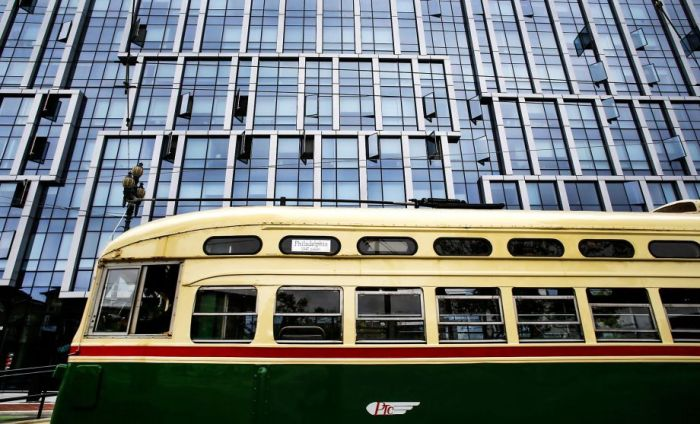 Streetcar No. 1055, wearing its original 1946 Philadelphia livery, passes new condos on Market at Buchanan. Michael Macor photo for the Chronicle.