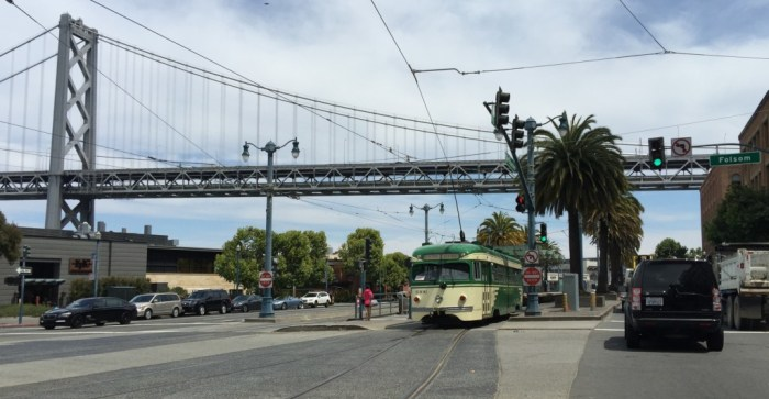PCC Streetcar No. 1006, training on the E-line June 30, 2015, joins the light rail tracks that emerge from the Market Street Subway at Folsom Street.