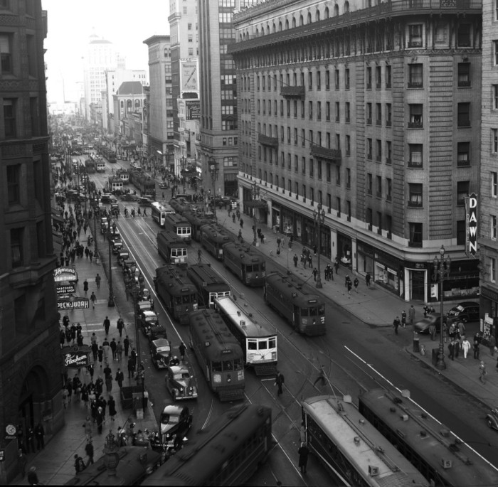In this 1940 shot from the SFMTA Archives, you can see automobiles jousting with streetcars for space on Market Street. This car-car clash was a big reason streetcars almost died out in the U.S.