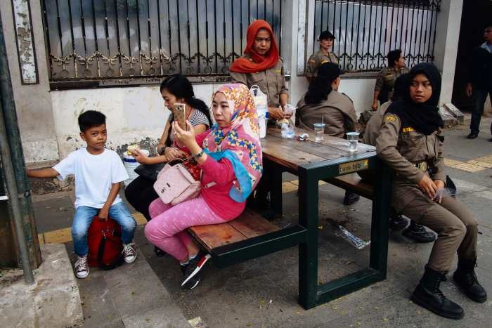 """""""Hatred"""" street photograph by Tomi Saputra"""