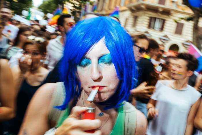 """Smoking"" street photograph by Guido Caltabiano"