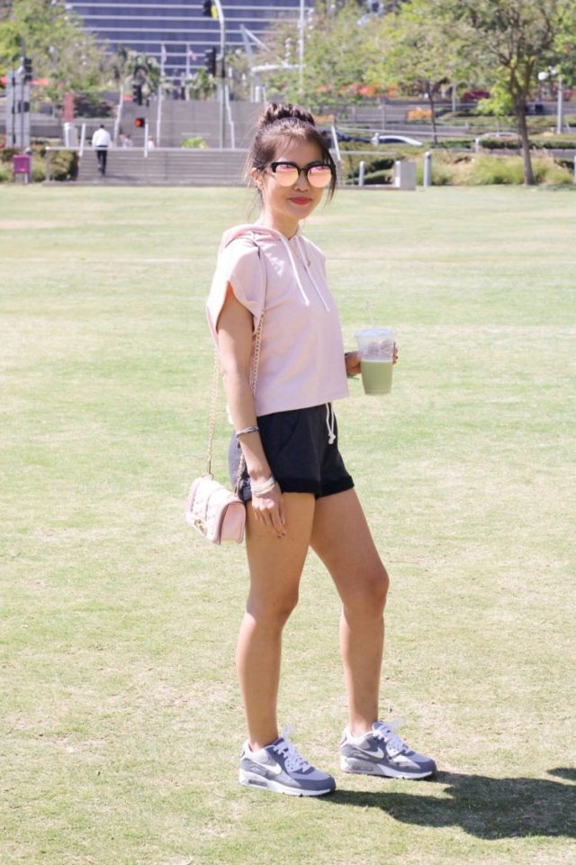 girl standing on grass in grand park