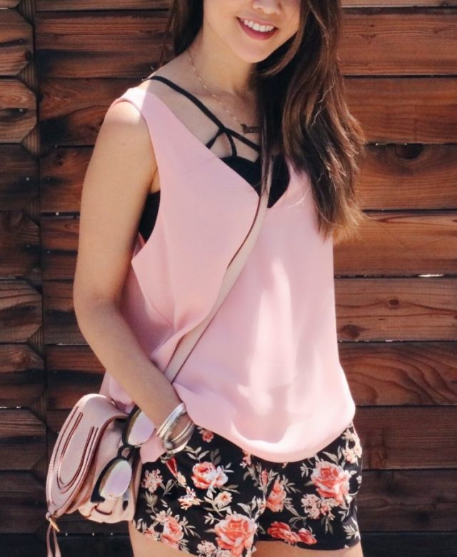 girl wearing pink top and floral shorts