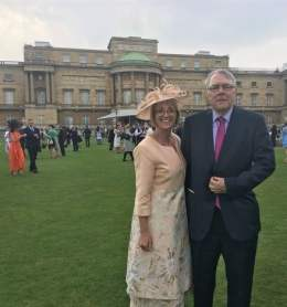 Chair David Watts and Street Pastor Tanya dressed up for the garden party