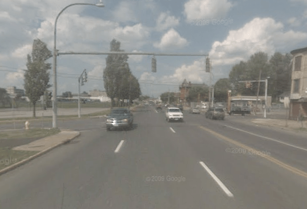 This intersection, the most dangerous in Syracuse, cant inspire too many people to walk or bike. If Albany passed a complete streets law, one of many green transportation policies they havent acted on, it could be safer. Image: Google Street View.