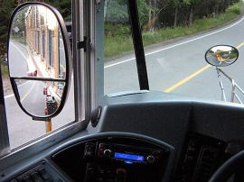The Cross Over Mirror, on the right, allows truck and school bus drivers to see in front of their hood. Photo: __.