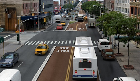 A rendering of the 34th Street Transitway shows how a design with a loading lane might shift to one without. Image: NYC DOT.