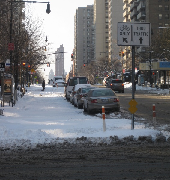 The new protected bike lane on Columbus Avenue remained unplowed at around 9:30 this morning. Photo: Noah Kazis.