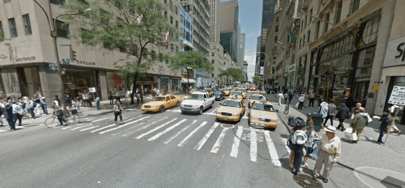 Fifth Avenue at 48th Street: Lots of space for cars; bike riders and walkers on the margins. Photo: Google Maps