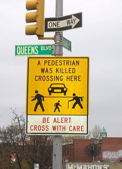 """Queens Boulevard continues to be """"a problem"""" for emergency physicians at Elmhurst and Jamaica Hospitals, along other area streets. Photo: ##http://en.wikipedia.org/wiki/File:QueensBlvd-GrandAve_PedWarning_Sign-Elmhurst.jpg##Wikipedia##"""