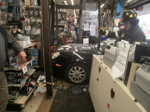 A driver on Staten Island crashed through the glass storefront. Photo: ##http://www.silive.com/news/index.ssf/2014/01/driver_smashes_through_reimans.html##Advance##