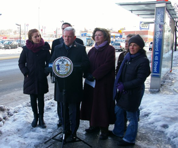 Advocates and fellow electeds with City Council Member Jimmy Van Bramer on Northern Boulevard, in front of a bus stop where five people were injured by a curb-jumping driver this month. Photo: Brad Aaron
