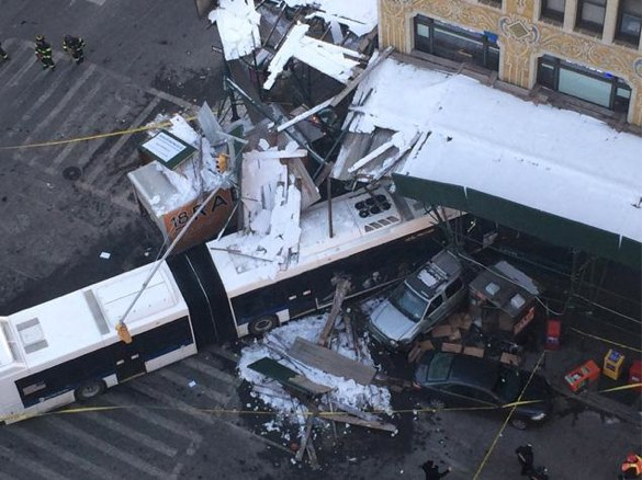 The driver of a stolen truck crashed into an MTA bus, killing the bus driver and injuring three others, including a food vendor who was on the sidewalk at Seventh Avenue and W. 14th Street. Photo: Daily News
