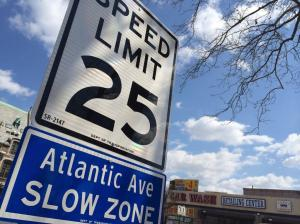 25 mph white-and-blue speed limit signs will join retimed lights on Atlantic Avenue and 24 other major streets. Photo: DHFixAtlantic/Twitter