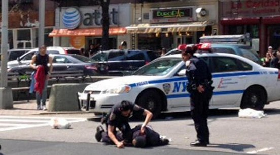 An officer in a marked NYPD cruiser struck and critically injured a 69-year-old pedestrian on Broadway. Witnesses contradicted NYPD accounts that the police were using lights and sirens. Photo: ##https://twitter.com/NBCNewYork/status/455425622085750784/photo/1##@NBCNewYork##