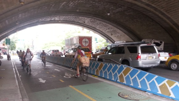 The two-way bike path on FIrst Avenue between 59th and 60th Streets now has a concrete barrier to match its tiled ceiling. Photo: Stephen Miller