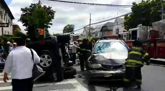 Another Midwood collision left one vehicle on its side. No serious injuries were reported. Photo: @NYScanner