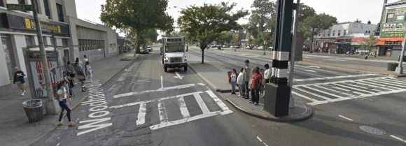 New York City can do better by bus riders and pedestrians on Woodhaven Boulevard, shown here at Jamaica Avenue. Photo: Google Maps
