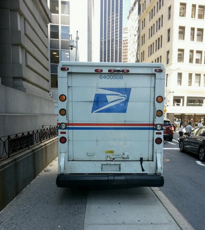 The U.S. Postal Service delivers near-total sidewalk obstruction to pedestrians at Broadway and State Street. Photo: ##https://twitter.com/simonsmith1978/status/485910301846822912/photo/1##@simonsmith1978##