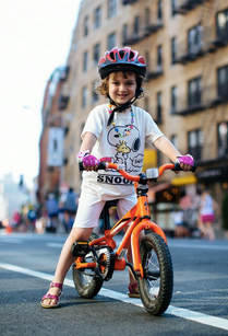 Galit Gordon is ready for the inaugural Kidical Mass NYC ride. Photo: Dmitry Gudkov via ##https://twitter.com/BrooklynSpoke/status/498895992528601088/photo/1##@BrooklynSpoke##