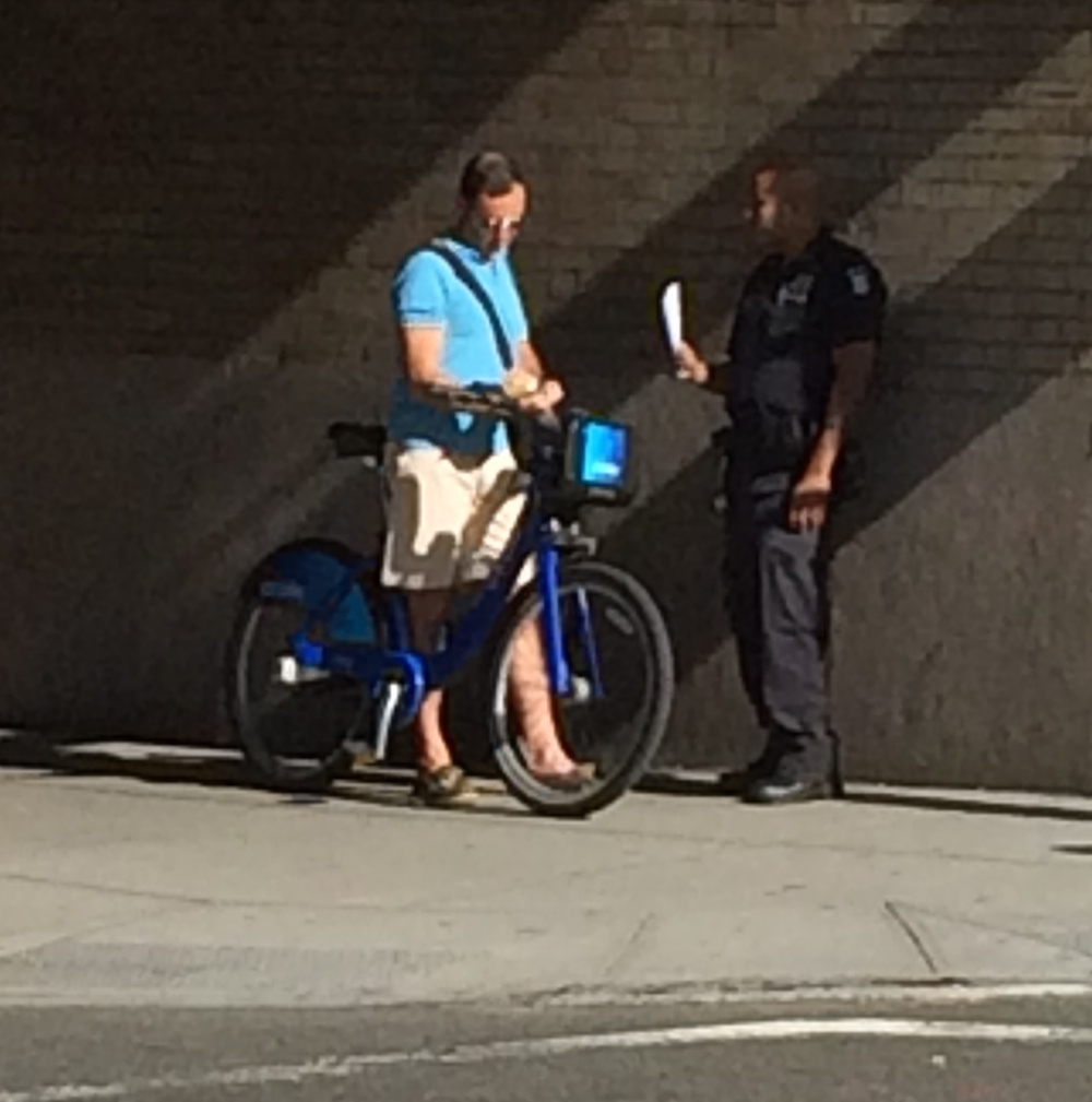 A reader photo of NYPD issuing tickets on Houston Street today.