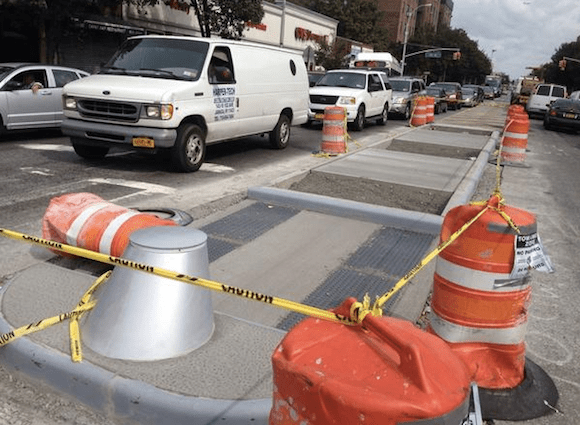 DOT has installed pedestrian islands on Northern Boulevard, including here at 89th Street. Photo: Clarence Eckerson Jr.