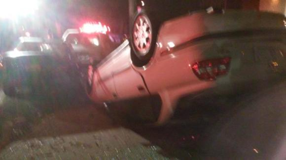 An allegedly drunk driver crashed into six parked cars last night, flipping one of them onto the sidewalk. Photo: Angus Grieve-Smith/Twitter