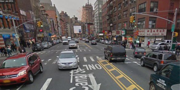 Canal Street, looking west, at Elizabeth Street, where a driver struck and killed a senior this morning. NYPD and a witness says the victim was crossing south to north (left to right) when the driver waiting at the light accelerated into her when the signal changed.  Image: Google Maps