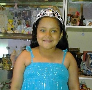 A motorist backed onto a sidewalk outside a Kingsbridge school, hitting 10 people and killing 8-year-old Rylee Ramos. No charges were filed by NYPD or Bronx DA Robert Johnson. Photo via Daily News