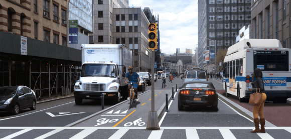 A two-way, center-running bikeway and a bus lane would be added to Jay Street south of Tillary Street under a concept suggested by Transportation Alternatives. Image: Street Plans Collaborative for Transportation Alternatives