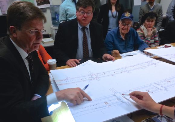 Queens Community Board 2 transportation committee chair Joseph Conley, left, looks at DOT's plan for Queens Boulevard in Woodside. Photo: Stephen Miller
