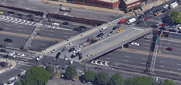 Does DOT really think that sharrows are enough to make this expressway on-ramp safe for cyclists? Photo: Google Maps