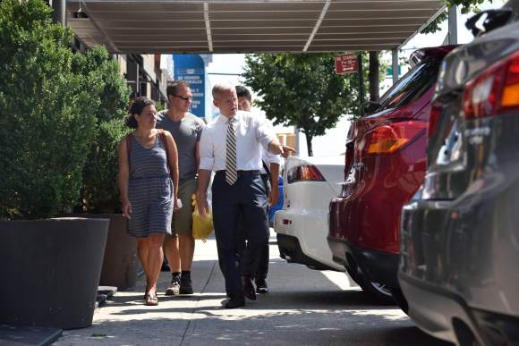 Council Member Jimmy Van Bramer isn't shopping for a new car at City Mitsubishi's dealership. He's trying to walk down the sidewalk on Northern Boulevard. Photo:  John McCarten/NYC Council