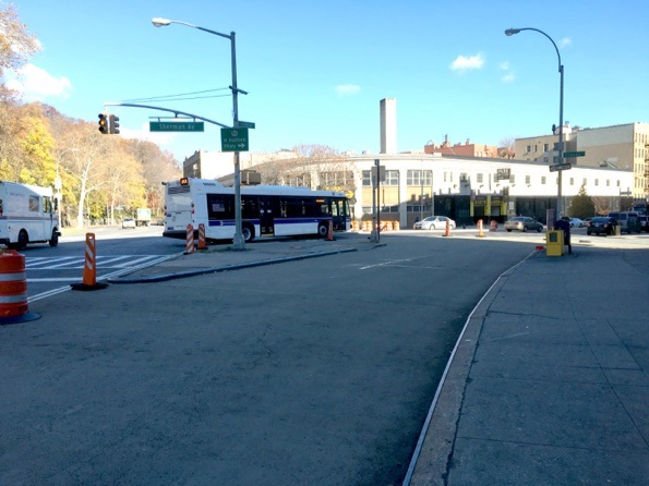 Drivers must make slower turns from Broadway onto Sherman Avenue after DOT eliminated a slip lane, now covered with epoxy, in the foreground. Photo: Brad Aaron