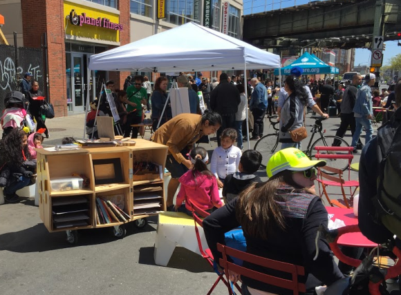 Kids and parents enjoyed a pop-up library at the plaza demo. Photo: David Meyer