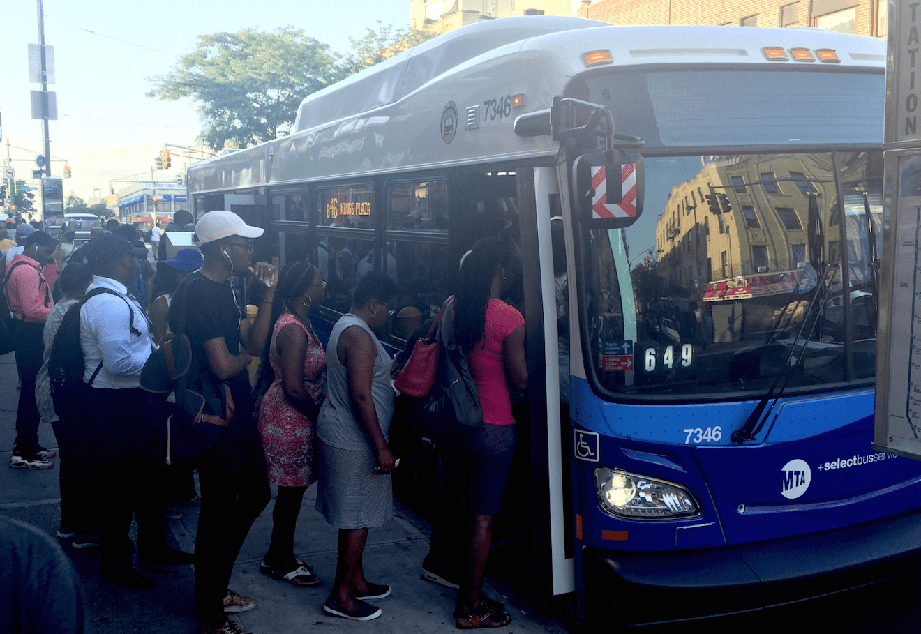 Riders board the B46 SBS at the bus stop where the route connects to the 3 and 4 trains. Photo: David Meyer