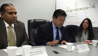 Council Member Peter Koo (center) spoke this afternoon alongside DDC Commissioner Feniosky Peña-Mora and DOT Queens Commissioner Nicole Garcia. Photo: David Meyer