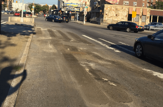DOT has began removing street markings on the blocks where it will soon install a protected bike lane and pedestrian path. Photo: Jessame Hannus