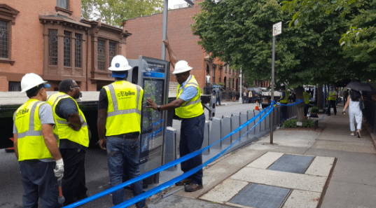 A station installation yesterday at Clinton Street and Congress Street in Cobble Hill. Photo: NYC DOT
