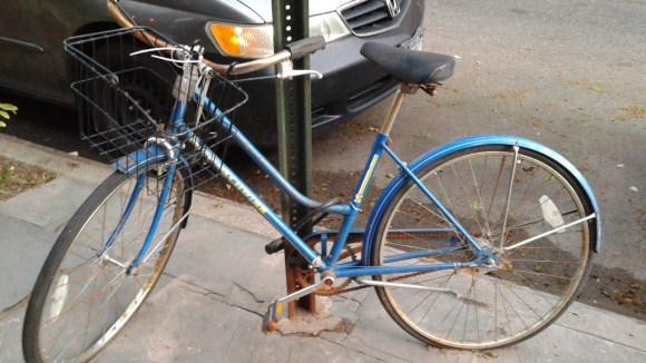 This blue Schwinn on President Street in Park Slope has been locked to the same pole for three years. Photo: Recycle-A-Bicycle