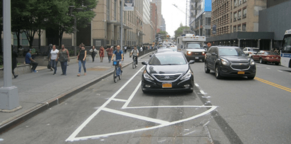 The city has flipped parked cars with bike lanes on Jay Street in downtown Brooklyn. Photo: NYC DOT