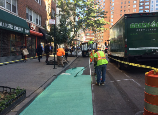 DOT crews installing a new protected bike lane on 4th Avenue between 12th and 13th Streets earlier this week. Photo: NYC DOT