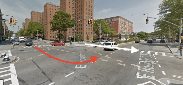 An MTA bus driver struck and killed Anna Colon on East Houston Street this morning. The white arrow indicates the direction the victim was walking and the red arrow indicates the approximate path of the driver. Image: Google Maps
